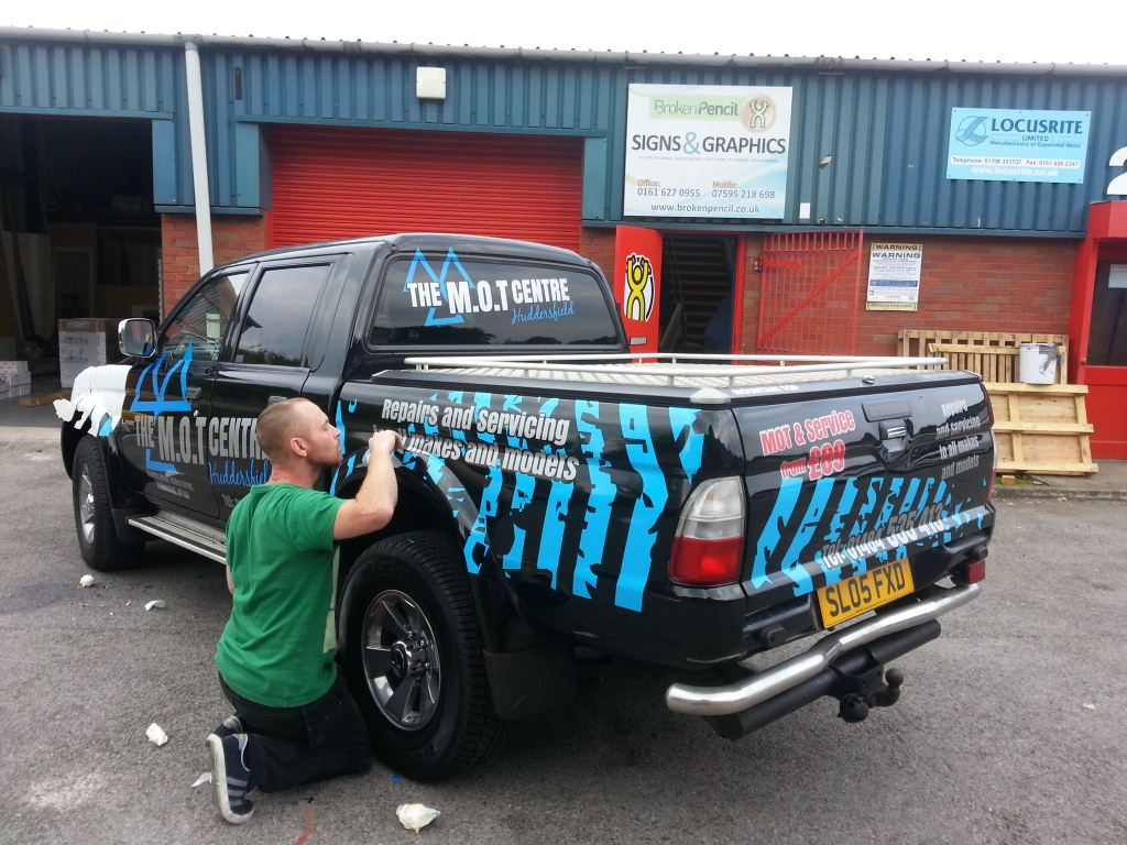 Commercial Vehicle Graphics being applied